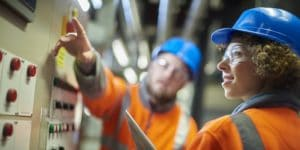 a man and woman in light industrial positions